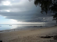 Beach, lagoon and the sky falling into the lagoon -
